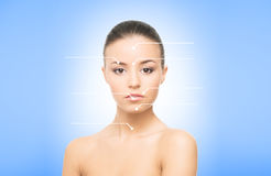 Portrait of a young woman with arrows on her face Stock Photography