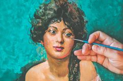 Portrait of young woman with artist hand and with a brush stock image