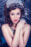 Portrait of young woman as Snow Queen character Royalty Free Stock Photography