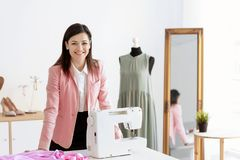 Portrait of young woman in atelier. Small business owner stock image