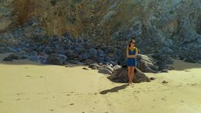 Portrait of young caucasian woman on Atlantic ocean sandy beach Portugal. Portrait of young woman on Atlantic ocean sandy beach in jeans dress in Portugal stock footage