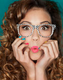 Portrait of young woman. Young attractive surprised woman wearing glasses Stock Photos