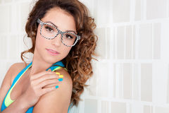 Portrait of young woman. Young attractive woman wearing glasses Stock Photo