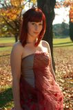 Portrait of young woman in autumn. Portrait of young woman in a park on a sunny autumn day royalty free stock photos
