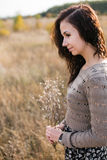 Portrait of a young woman with autumn bouquet Stock Photography