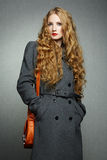 Portrait of young woman in autumn coat Stock Image