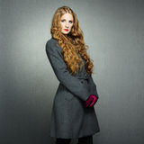 Portrait of young woman in autumn coat Stock Photos