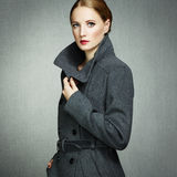 Portrait of young woman in autumn coat Royalty Free Stock Images