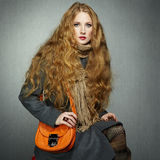 Portrait of young woman in autumn coat Stock Photography