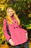 Portrait of young woman in autumn park Stock Photos