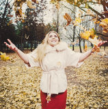 Portrait of young woman. In autumn park royalty free stock images