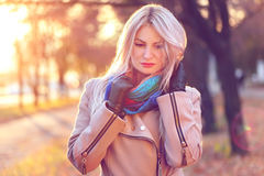 Portrait of young woman in autumn park royalty free stock image