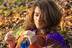 Portrait of young woman in autumn season Royalty Free Stock Image