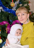 Portrait of the young woman with the baby in the Snowflake suit Stock Photos