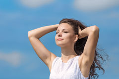 Portrait of young woman on background of sky Royalty Free Stock Photos