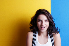 Portrait of a young woman on the background of Ukrainian flag. Royalty Free Stock Photo