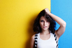 Portrait of a young woman on the background of Ukrainian flag. Royalty Free Stock Photography