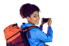 Portrait of a young woman with backpack looking back Royalty Free Stock Images
