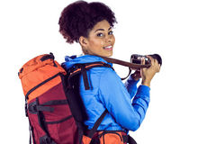 Portrait of a young woman with backpack taking picture Royalty Free Stock Photo