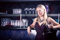 In the bar. Portrait of a young woman in the bar Royalty Free Stock Image