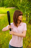 Portrait of young woman with bat Royalty Free Stock Images