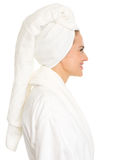 Portrait of young woman in bathrobe in profile Stock Photo