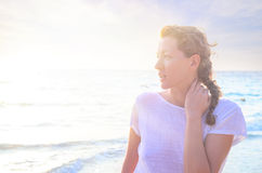 Portrait of young woman at the beach Stock Images