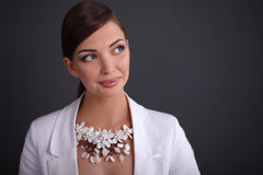 Portrait of young woman with beads, isolated on Royalty Free Stock Image