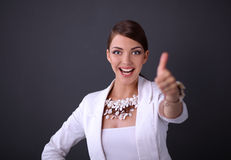 Portrait of young woman with beads showing ok Royalty Free Stock Photography