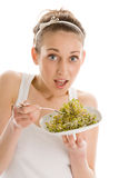Woman eating bean sprouts Royalty Free Stock Photography