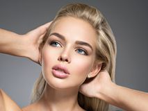 Young Woman with beautiful face. Portrait of  a Young Woman with beautiful face, brown make-up.  Pretty gorgeous girl with  blue eyes -  posing at studio Royalty Free Stock Photography