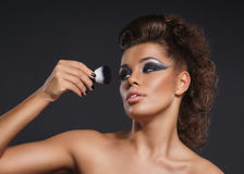 Portrait of a young woman in a beautiful makeup Stock Photos