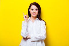 Portrait of young woman. Portrait of the beautiful young woman on the yellow background Stock Photos