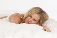 Portrait of young woman in bed Royalty Free Stock Photography