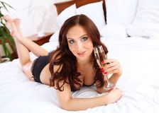 Portrait of a young woman in bed Royalty Free Stock Images