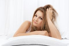 Portrait of the young woman in bed Royalty Free Stock Image