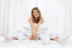 Portrait of the young woman in bed Royalty Free Stock Photos