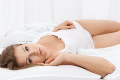 Portrait of the young woman in bed Royalty Free Stock Photography