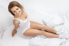 Portrait of the young woman in bed Stock Photo