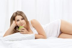 Portrait of the young woman in bed Royalty Free Stock Images