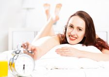 Portrait of a young woman in the bedroom Royalty Free Stock Image
