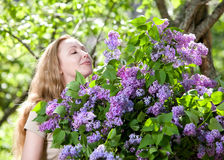Portrait of the young woman with a big bouquet of a lilac Royalty Free Stock Photo