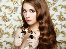 Portrait of young woman with binoculars royalty free stock photography