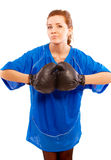 Portrait of young woman in black boxing gloves Stock Photos