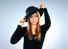 Portrait of a young woman in a black hat Royalty Free Stock Photography