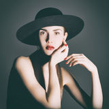 Portrait of young woman in a black hat. Studio photo young woman in black with graphic quality lighting Royalty Free Stock Photo