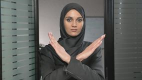 Portrait of Young woman in black hijab showing stop sign, Dislike, Rejecting Gesture, Disagree Sign, Crossing hands 60. Fps 4k stock video