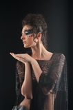 Portrait of young woman in black shawl Stock Photography