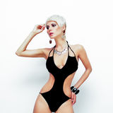 Portrait of a young woman in a black swimsuit. Fashion portrait of a young woman in a black swimsuit Stock Photography