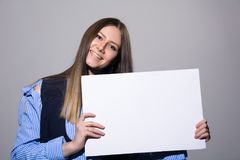 Portrait of a young woman with a blank white banner Stock Image